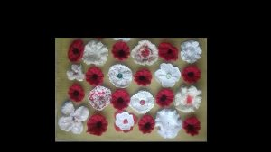 Photo of red and white knitted poppies