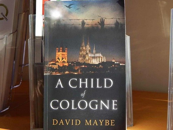 Cover of the book 'A child of Cologne' showing the cathedral.