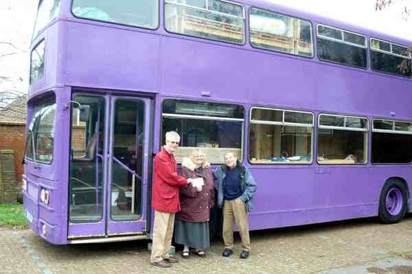 Donation being presented to Foodshare, in front of the bus that they use to provide accomodation