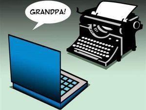 laptop computer calling old typewriter 'grandpa'