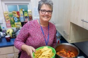 Angela, Quaker chaplain to Reading University, serves vegetarian chilli to students