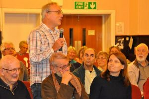 Audience member posing a question to parliamentary candidates at the Reading Quakers' general election hustings November 2019